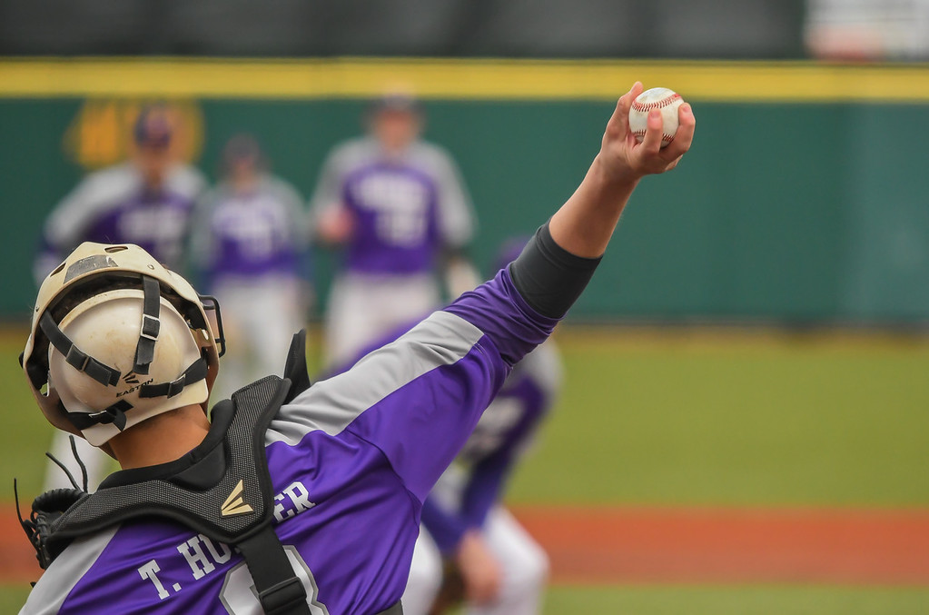 . Eric Bonzar�The Morning Journal<br> Avon catcher Tyler Hunter throws down to second during warm-up.