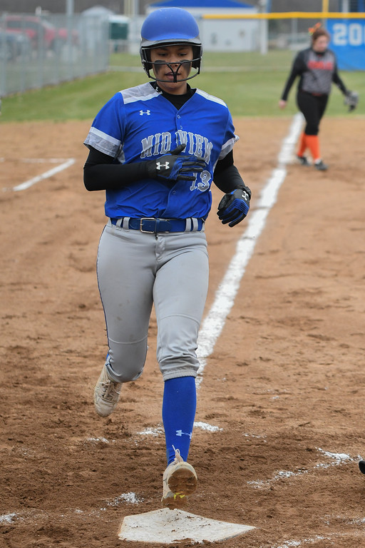 . Eric Bonzar�The Morning Journal<br> Midview\'s Kaeli Evins crosses home plate after a two-run, in the park, home run, April 6, 2018. The Middies erupted for eight runs, in the first inning, against the North Olmsted Eagles.