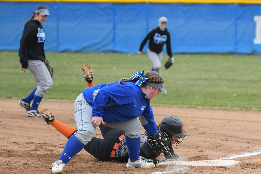. Eric Bonzar�The Morning Journal<br> North Olmsted\'s Grace Laurenzi slides safely back into first as Midview\'s Faith Hamilton applies the tag, April 6, 2018.
