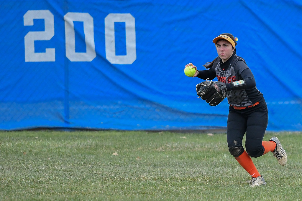 . Eric Bonzar�The Morning Journal<br> North Olmsted center fielder Alex Balson fields a ball in the outfield,  April 6, 2018.