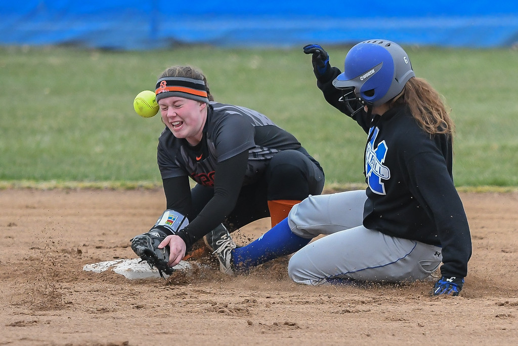 . Eric Bonzar�The Morning Journal<br> Midview\'s Katie Weaver steals second as North Olmsted\'s Grace Laurenzi cannot handle the throw from catcher Cassie Burkey, April 6, 2018.