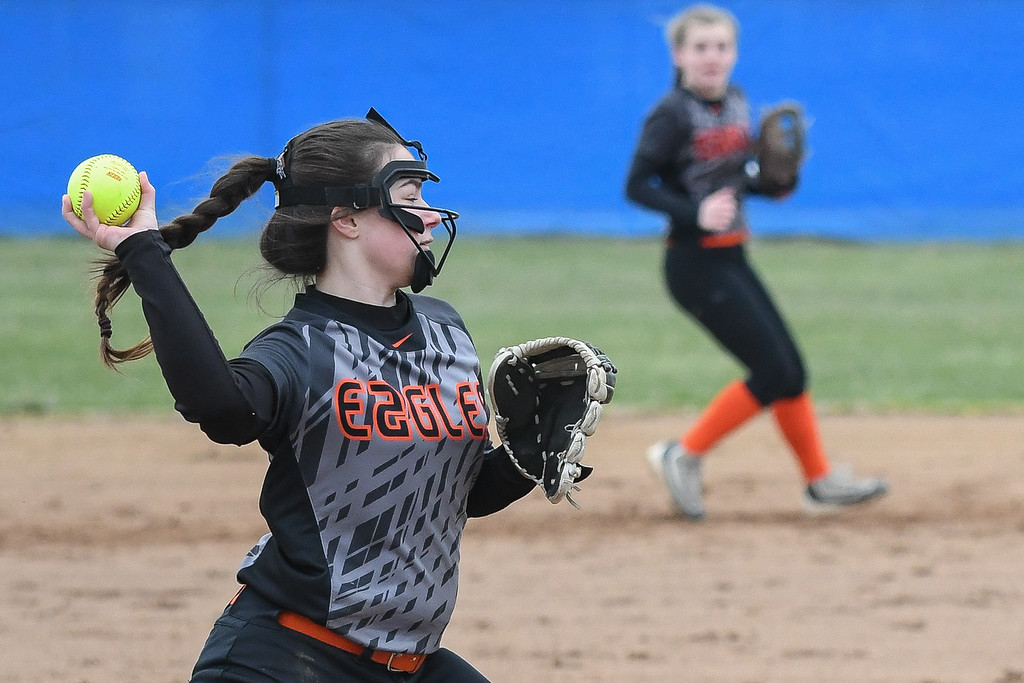 . Eric Bonzar�The Morning Journal<br> North Olmsted pitcher Abby Rigda throws to first after fielding a bunt, April 6, 2018.