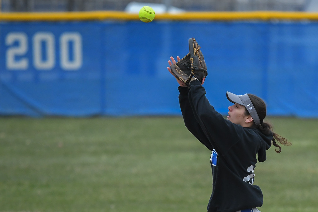 . Eric Bonzar�The Morning Journal<br> Midview\'s Hailey Ivan camps under an infield pop fly, April 6, 2018.