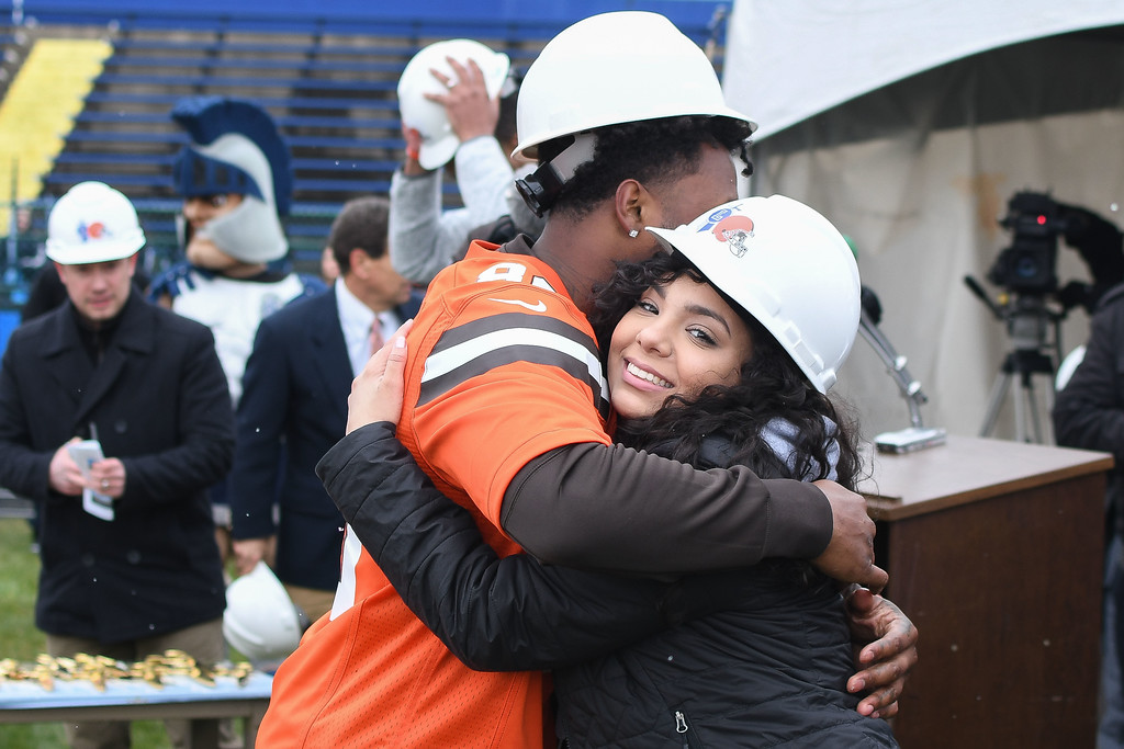 . Eric Bonzar�The Morning Journal<br> Girls soccer player Nyaha Espitia gets a hug from Cleveland Browns wide receiver Jarvis Landry during a ground breaking event held at George Daniel Field, April 17, 2018. Through the generosity of the Cleveland Browns organization and Dee and Jimmy Haslam, Lorain High School athletes will be able to play sports on a high-quality synthetic turf field beginning this fall.