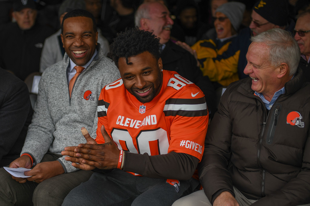 . Eric Bonzar�The Morning Journal<br> Browns wide receiver Jarvis Landry, center, owner Jimmy Haslam,  right, and Lorain City Schools CEO David Hardy Jr. share a laugh during a ground breaking event held at George Daniel Field, April 17, 2018. Through the generosity of the Cleveland Browns organization and Dee and Jimmy Haslam, Lorain High School athletes will be able to play sports on a high-quality synthetic turf field beginning this fall.