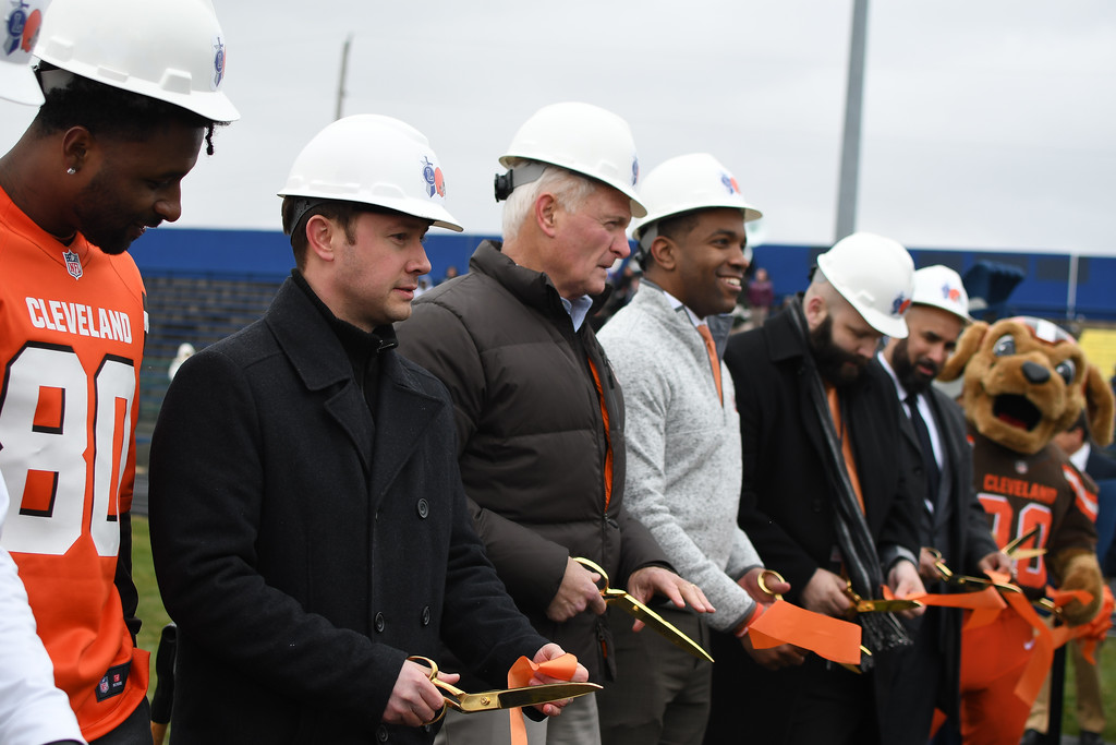 . Eric Bonzar�The Morning Journal<br> From left: Cleveland Browns wide receiver Jarvis Landry, Lorain Mayor Chase Ritenauer, Browns Owner Jimmy Haslam and Lorain City Schools CEO David Hardy Jr. cut the ribbon during a ground breaking event held at George Daniel Field, April 17, 2018. Through the generosity of the Cleveland Browns organization and Dee and Jimmy Haslam, Lorain High School athletes will be able to play sports on a high-quality synthetic turf field beginning this fall.