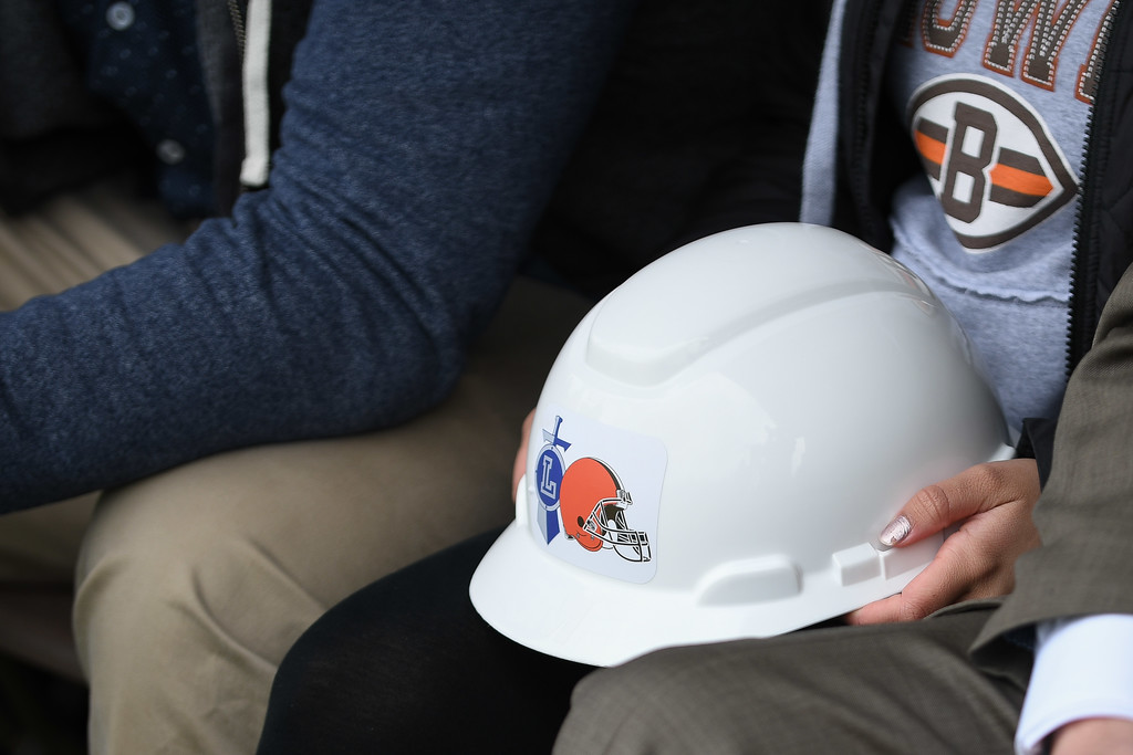 . Eric Bonzar�The Morning Journal<br> Girls soccer player Nyaha Espitia holds onto her hard hat during a ground breaking event held at George Daniel Field, April 17, 2018. Through the generosity of the Cleveland Browns organization and Dee and Jimmy Haslam, Lorain High School athletes will be able to play sports on a high-quality synthetic turf field beginning this fall.