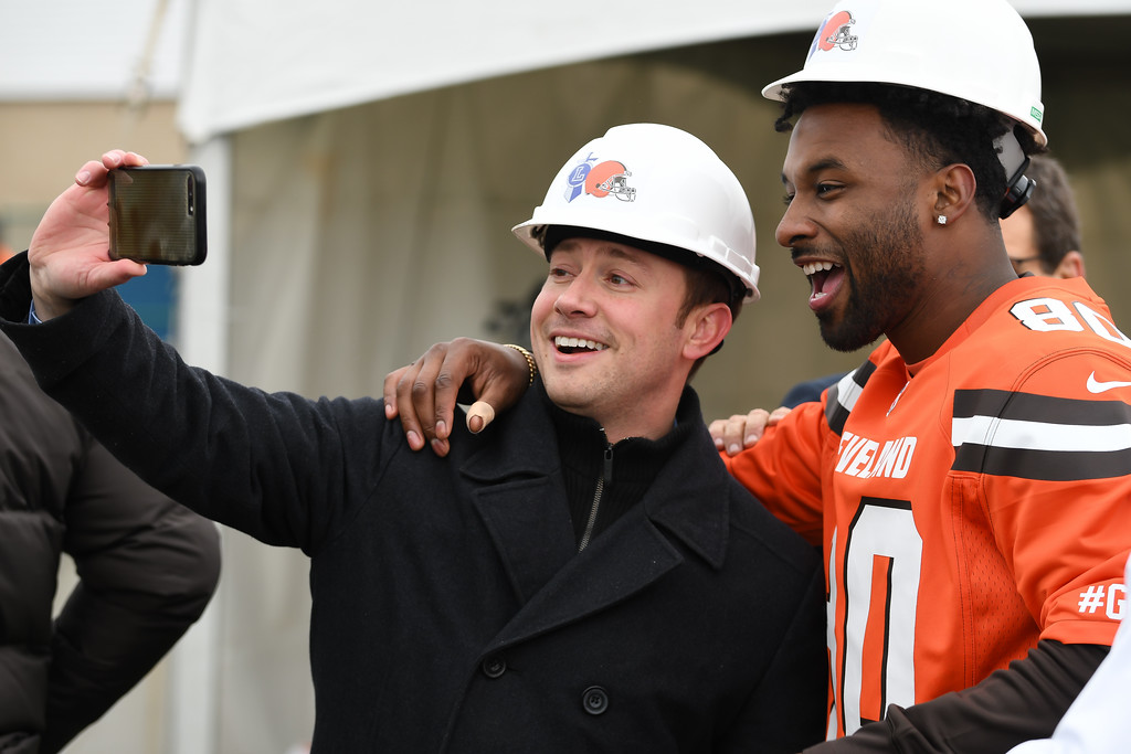 . Eric Bonzar�The Morning Journal<br> Lorain Mayor Chase Ritenauer takes a selfie with Cleveland Browns wide receiver Jarvis Landry during a ground breaking event held at George Daniel Field, April 17, 2018. Through the generosity of the Cleveland Browns organization and Dee and Jimmy Haslam, Lorain High School athletes will be able to play sports on a high-quality synthetic turf field beginning this fall.