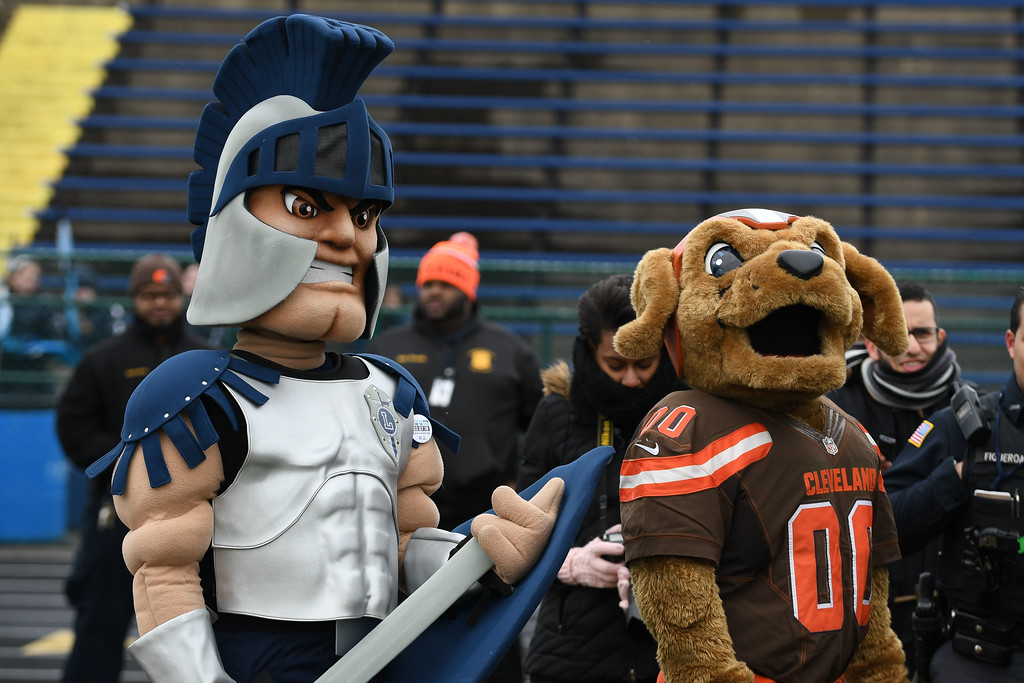. Eric Bonzar�The Morning Journal<br> Cleveland Browns mascot Chomps, right, and Lorain City Schools mascot Titus hang out together during a ground breaking event held at George Daniel Field, April 17, 2018. Through the generosity of the Cleveland Browns organization and Dee and Jimmy Haslam, Lorain High School athletes will be able to play sports on a high-quality synthetic turf field beginning this fall.