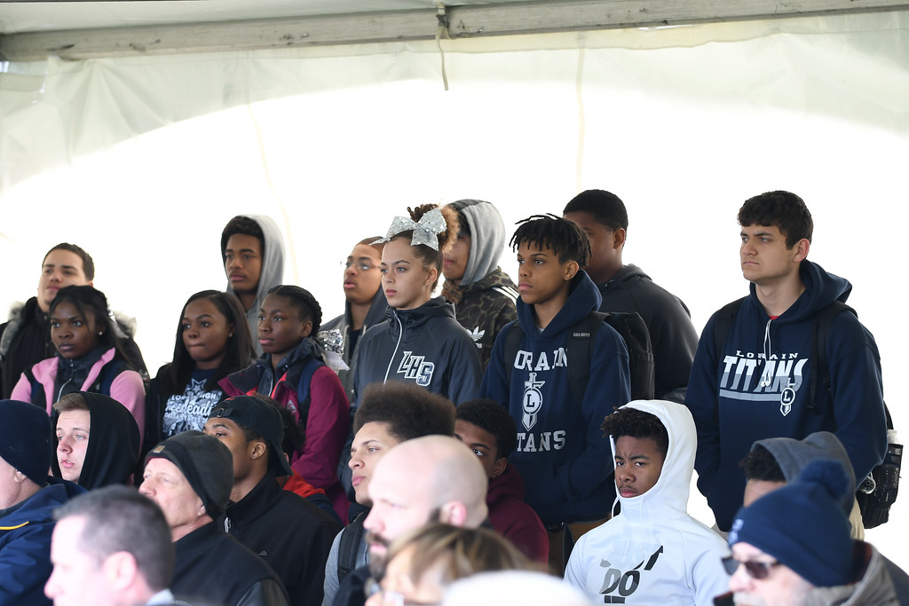 . Eric Bonzar�The Morning Journal<br> Lorain High School scholars listen to Cleveland Browns Owner Jimmy Haslam during a ground breaking event held at George Daniel Field, April 17, 2018. Through the generosity of the Cleveland Browns organization and Dee and Jimmy Haslam, Lorain High School athletes will be able to play sports on a high-quality synthetic turf field beginning this fall.