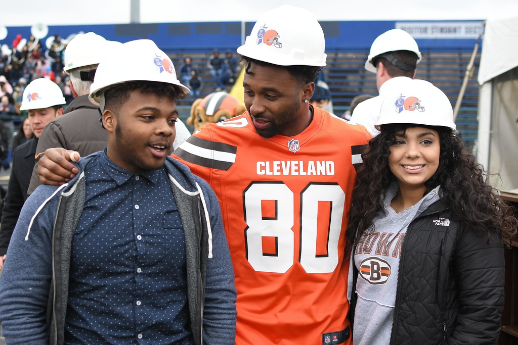 . Eric Bonzar�The Morning Journal<br> Girls soccer player Nyaha Espitia and football player Cairo Smith hang out with Cleveland Browns wide receiver Jarvis Landry during a ground breaking event held at George Daniel Field, April 17, 2018. Through the generosity of the Cleveland Browns organization and Dee and Jimmy Haslam, Lorain High School athletes will be able to play sports on a high-quality synthetic turf field beginning this fall.