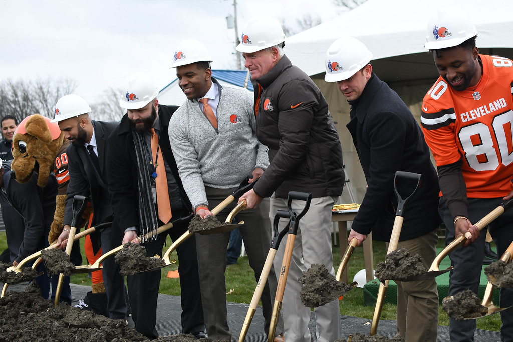 . Eric Bonzar�The Morning Journal<br> From right: Cleveland Browns wide receiver Jarvis Landry, Lorain Mayor Chase Ritenauer, Browns Owner Jimmy Haslam,  Lorain City Schools CEO David Hardy Jr., and district Treasurer Josh Hill turn a shovel of dirt during a ground breaking event held at George Daniel Field, April 17, 2018. Through the generosity of the Cleveland Browns organization and Dee and Jimmy Haslam, Lorain High School athletes will be able to play sports on a high-quality synthetic turf field beginning this fall.