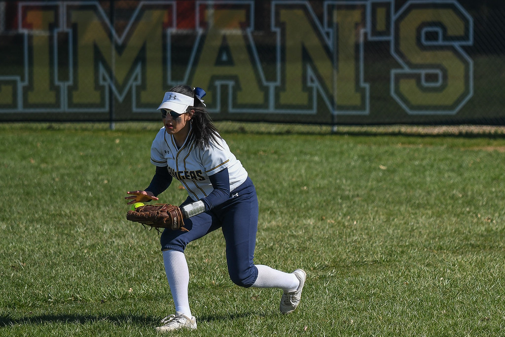 . Eric Bonzar�The Morning Journal<br> North Ridgeville right fielder Gianna Vazquez bobbles a ball in the outfield, April 19, 2018.