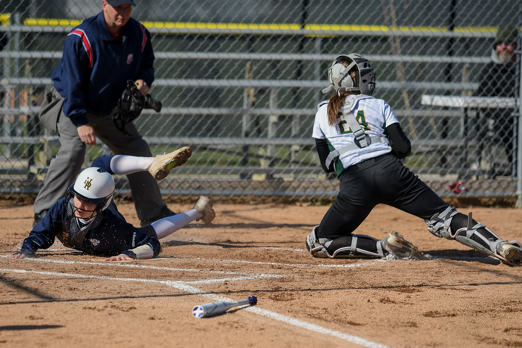 . Eric Bonzar�The Morning Journal<br> North Ridgeville\'s Rachel Mease is tagged out at home plate by Amherst catcher Lauren Kachure, April 19, 2018.