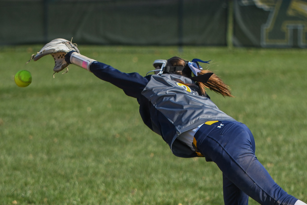 . Eric Bonzar�The Morning Journal<br> North Ridgeville second baseman Rachel Mease stretches out but cannot pull in a shot up the middle, April 19, 2018.