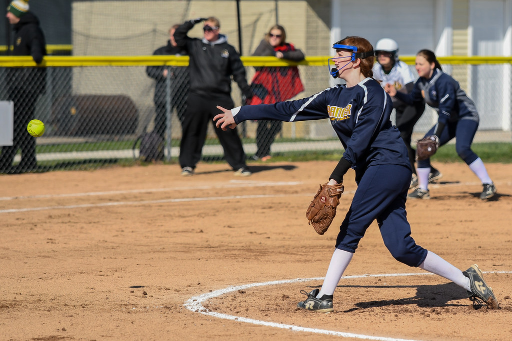 . Eric Bonzar�The Morning Journal<br> North Ridgeville\'s Kaleigh Rukavina delivers a pitch with a runner on third base, April 19, 2018.