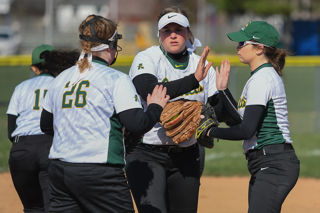 . Eric Bonzar�The Morning Journal<br> Amherst pitcher Madison O\'Berg high fives teammates Kylee McGraw (26) and Lindsey Reavis before going to work in the second inning, against the North Ridgeville Rangers, April 19, 2018.
