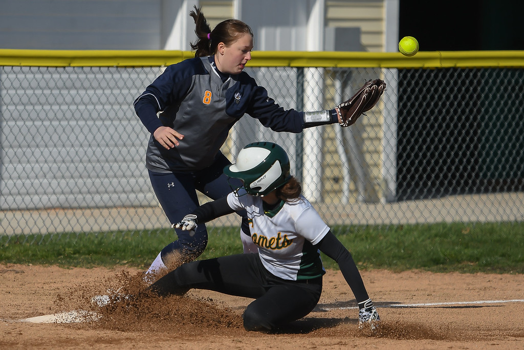 . Eric Bonzar�The Morning Journal<br> Amherst\'s Lindsey Reavis slides into third base as North Ridgeville\'s Hailey Gunvalsen cannot hang onto the ball,  April 19, 2018.