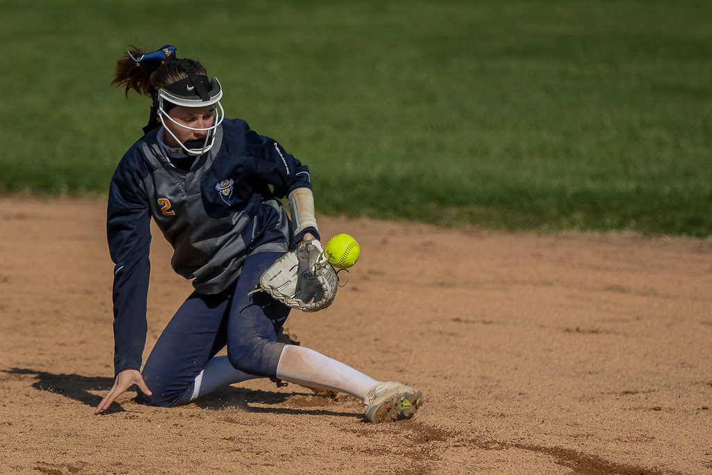 . Eric Bonzar�The Morning Journal<br> North Ridgeville second baseman Rachel Mease loses a line shot in the infield, April 19, 2018.