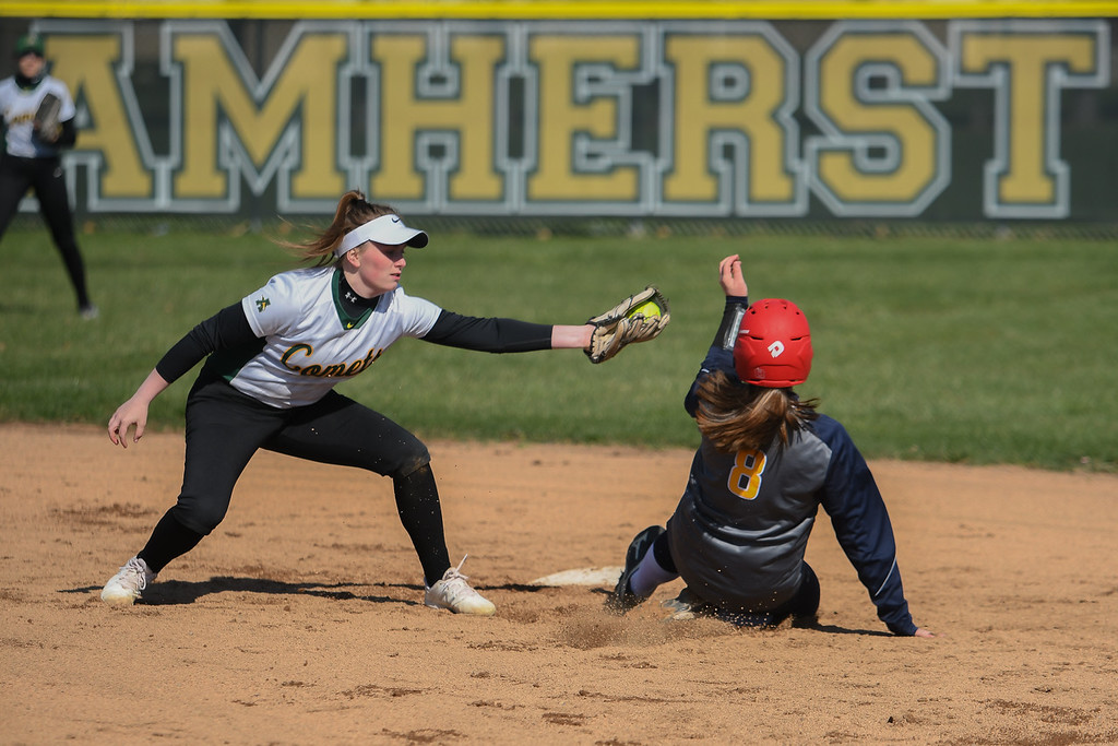 . Eric Bonzar�The Morning Journal<br> North Ridgeville\'s Hailey Gunvalsen slides into second base under the tag of Amherst\'s Kasey McGraw, April 19, 2018.
