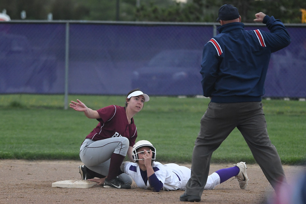 . Eric Bonzar�The Morning Journal<br> Keystone\'s Autumn Accord is punched out at second base as she is tagged by Rocky River\'s Elayna Hallal, May 11, 2018.
