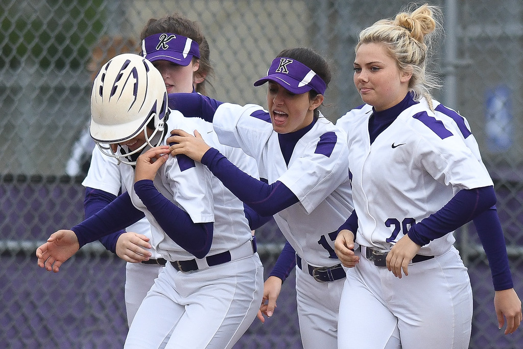 . Eric Bonzar�The Morning Journal<br> Keystone\'s Madi Nunez is mobbed at home plate by her teammates after hitting her first home run of the game, May 11, 2018. Nunez had four home runs and and seven RBIs in the Wildcats\' 21-0 win over the Rocky River Pirates.