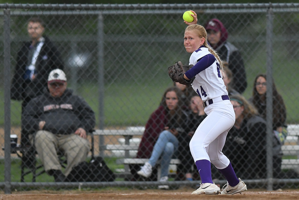 . Eric Bonzar�The Morning Journal<br> Keystone\'s Val Broschk throws to first base for the out.