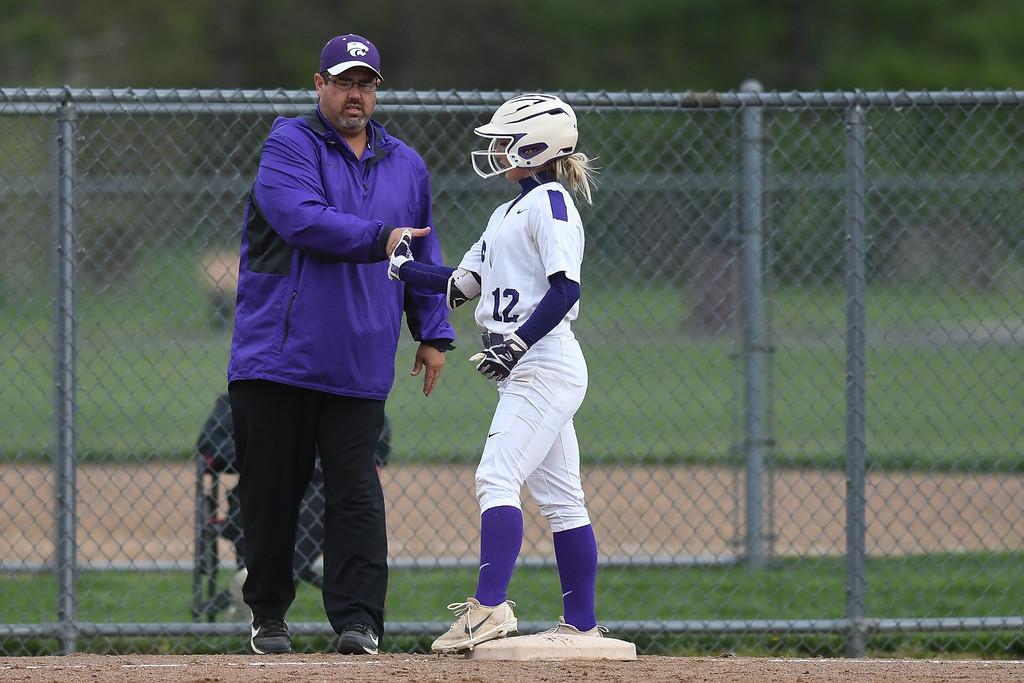 . Eric Bonzar�The Morning Journal<br> Keyston\'s Marlie McNulty celebrates a triple with Head Coach Jim Piazza, May 11, 2018.