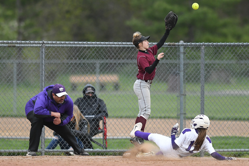 . Eric Bonzar�The Morning Journal<br> Keystone\'s Alexis Bowen slides into third base as Rocky River\'s Catie Wolons is overthrown on the play.