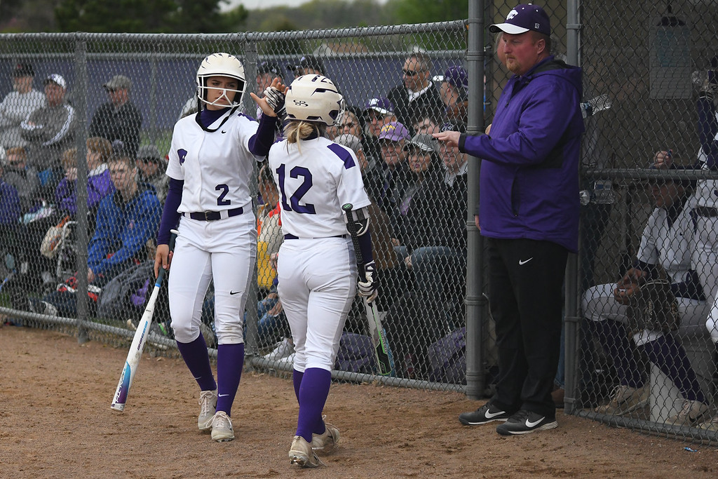 . Eric Bonzar�The Morning Journal<br> Keystone\'s Madi Nunez (2) celebrates a run scored with teammate Marlie McNulty, May 11, 2018. Nunez had four home runs and and seven RBIs in the Wildcats\' 21-0 win over the Rocky River Pirates.