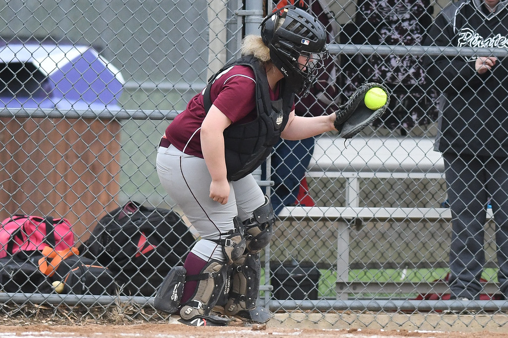 . Eric Bonzar�The Morning Journal<br> Rocky River catcher Mo McIntyre catches a pop-up at home plate, May 11, 2018.