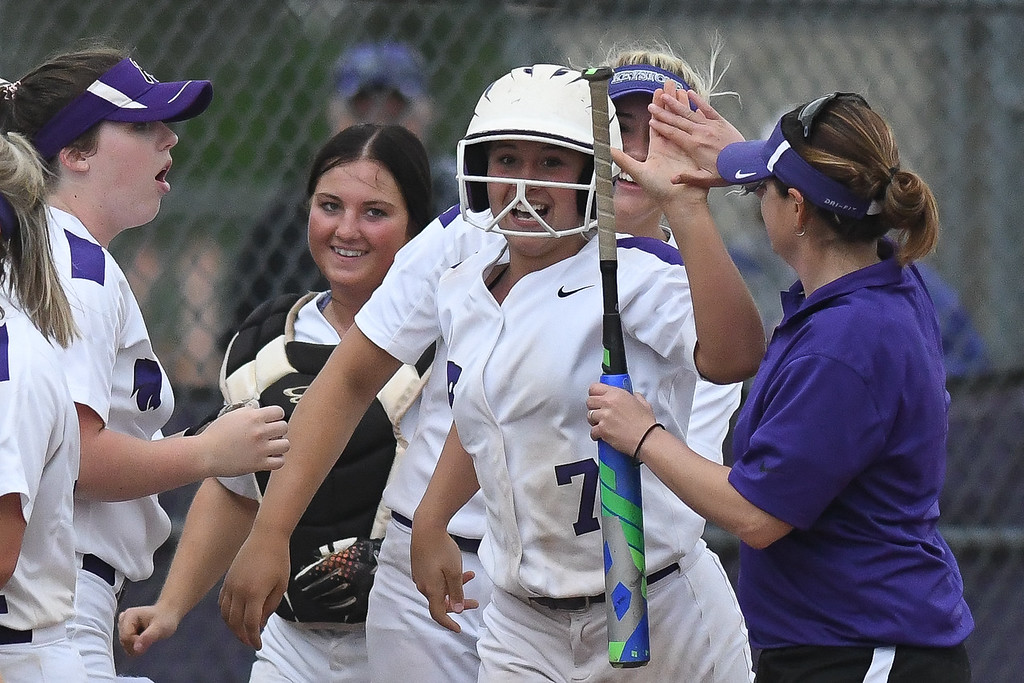 . Eric Bonzar�The Morning Journal<br> Keystone\'s Autumn Acord (7) celebrates her two-run home run which put the Wildcats up 3-0 on Holy Name.