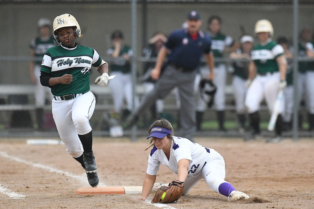 . Eric Bonzar�The Morning Journal<br> Keystone first baseman Brooke Piazza fields a shot up the line, from Holy Name\'s Anessa Whitlow, for the out.