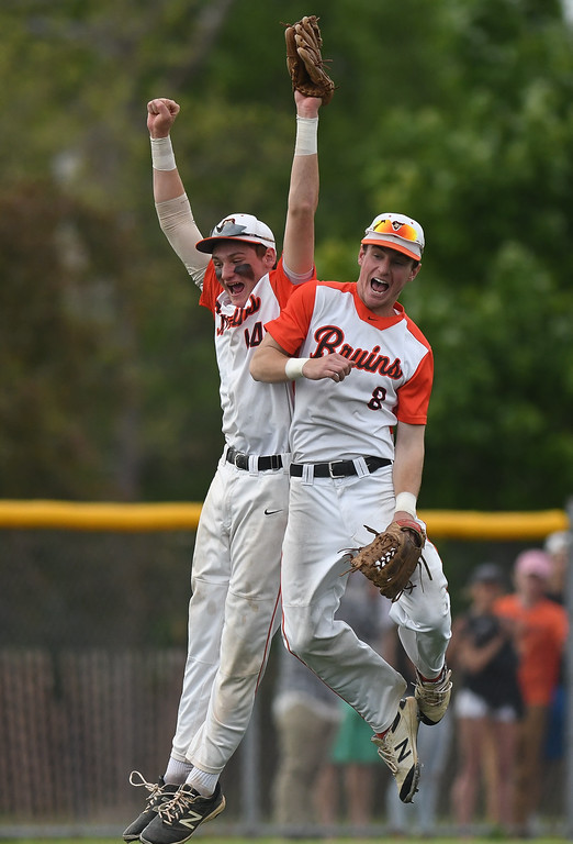. Eric Bonzar�The Morning Journal Padua\'s Alex Ludwick (14) and Kevin Houdek (8) celebrate the Bruins\' 1-0 district finals win over the Bay Rockets, May 20, 2016.