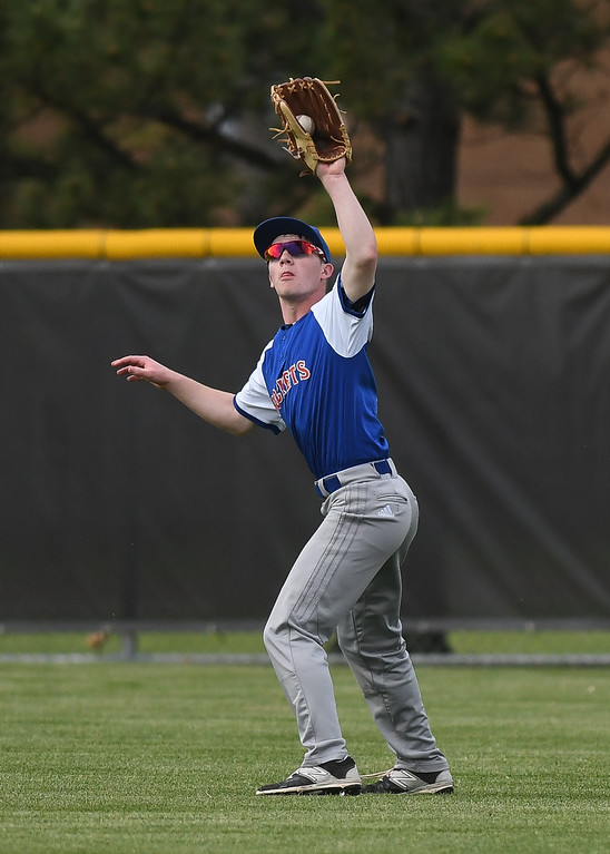 . Eric Bonzar�The Morning Journal Bay center fielder Parker Thompson snags a fly ball, May 20, 2016.