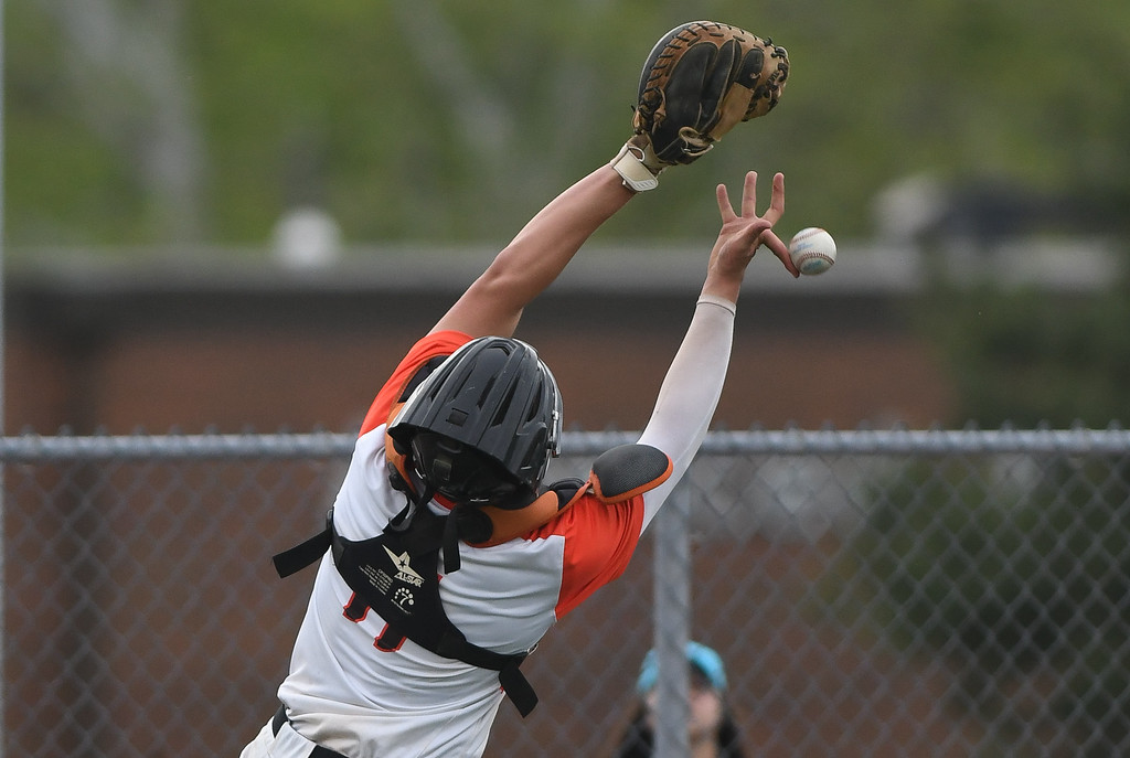. Eric Bonzar�The Morning Journal Padua catcher Michael Kilner can\'t hang on to a pop-up at home plate, May 20, 2016.