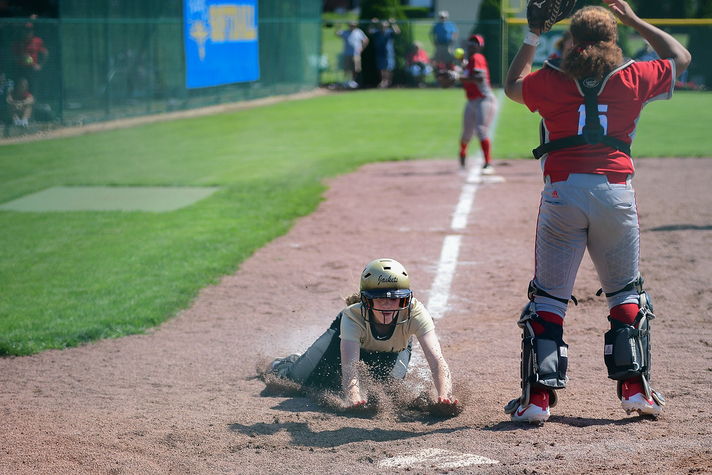 . Eric Bonzar�The Morning Journal<br> Perrysburg\'s Marissa Thomas slides into home plate, in the bottom of the 10th inning, giving the Yellow Jackets a 1-0 win over the defending Division I champion Elyria Pioneers, May 23, 2018.