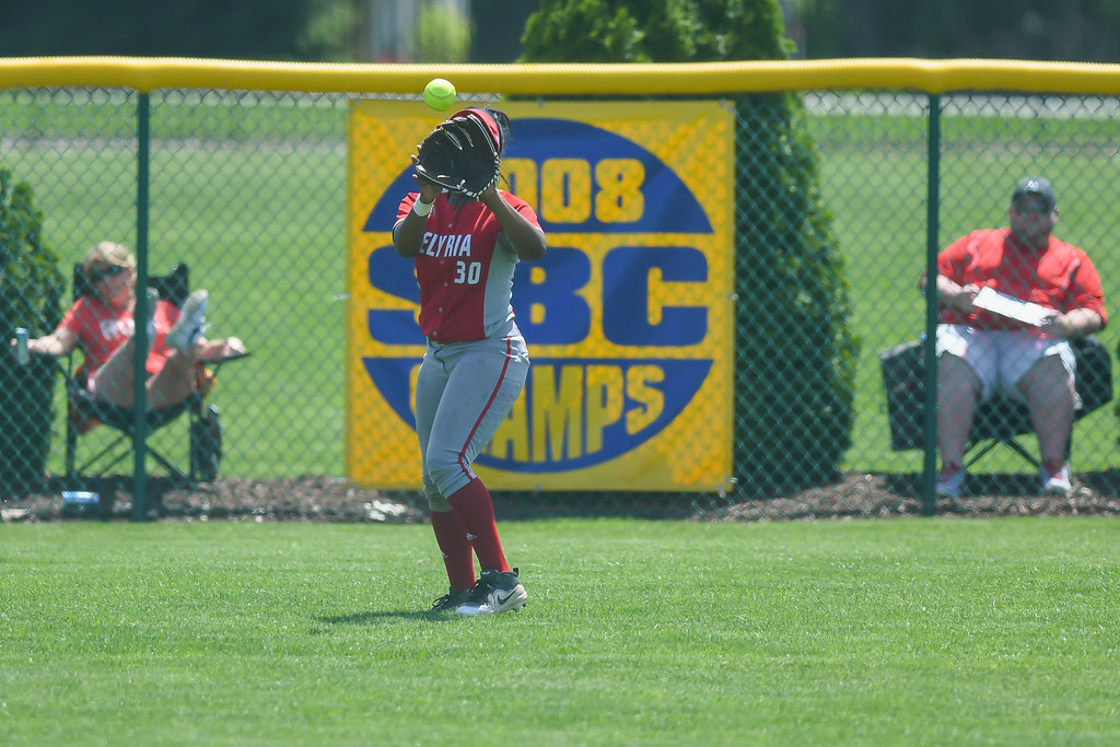 . Eric Bonzar�The Morning Journal<br> Elyria\'s Damia Parks makes a catch in left field.