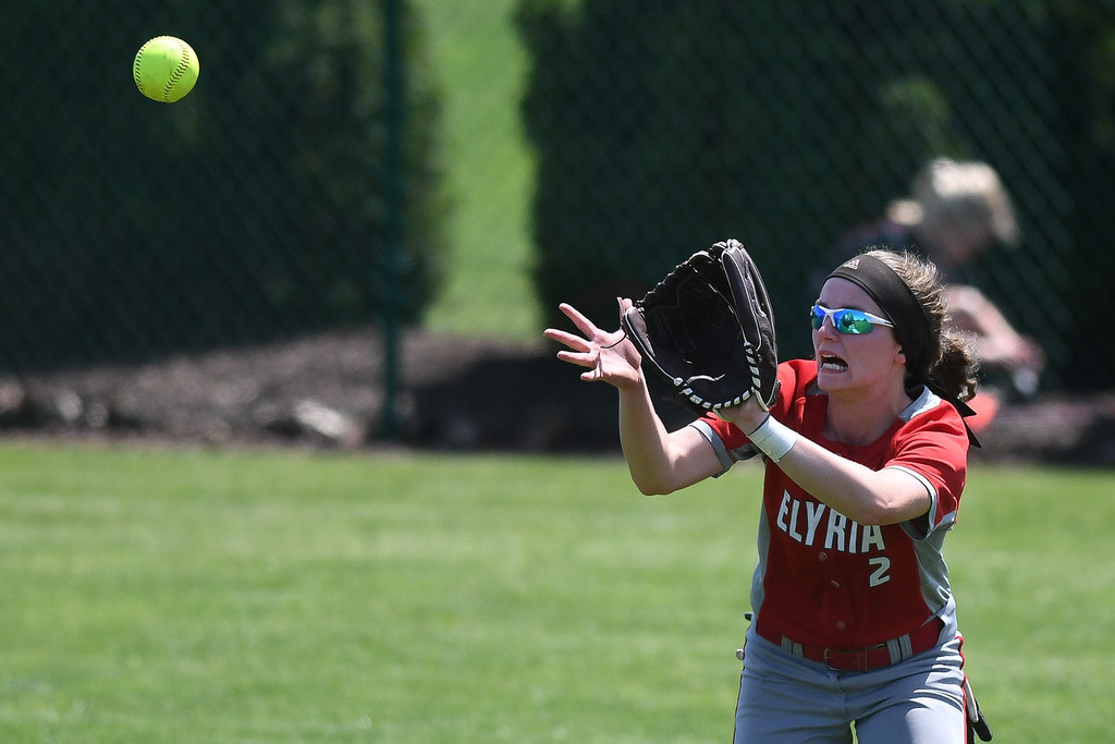. Eric Bonzar�The Morning Journal<br> Elyria\'s Macy Taylor tracks down a fly ball in center field.