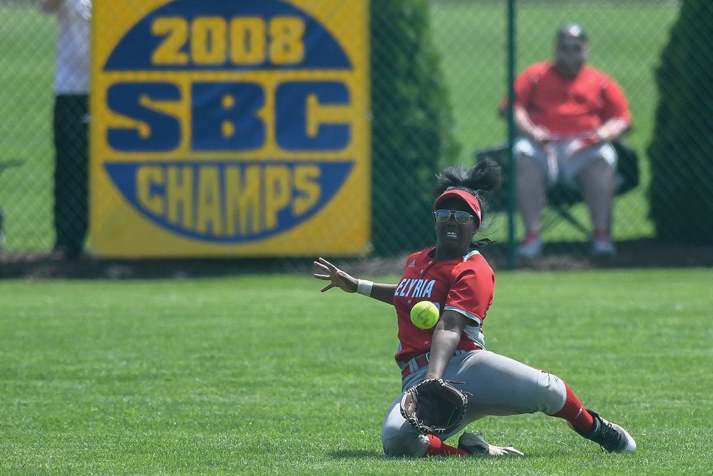 . Eric Bonzar�The Morning Journal<br> Elyria\'s Damia Parks makes a sliding catch in left field.