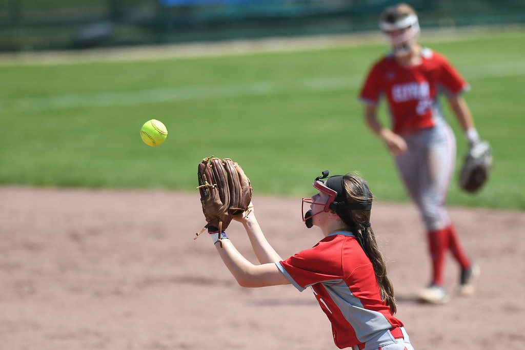 . Eric Bonzar�The Morning Journal<br> Elyria second baseman Jessica Chapman fields an infield fly.
