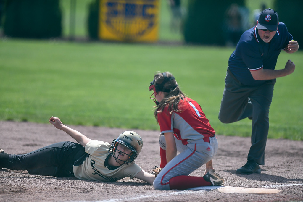 . Eric Bonzar�The Morning Journal<br> Perrysburg\'s Brooke Miller is punched out at first base as she\'s tagged by Elyria\'s Jessica Chapman, in the bottom of the seventh inning.