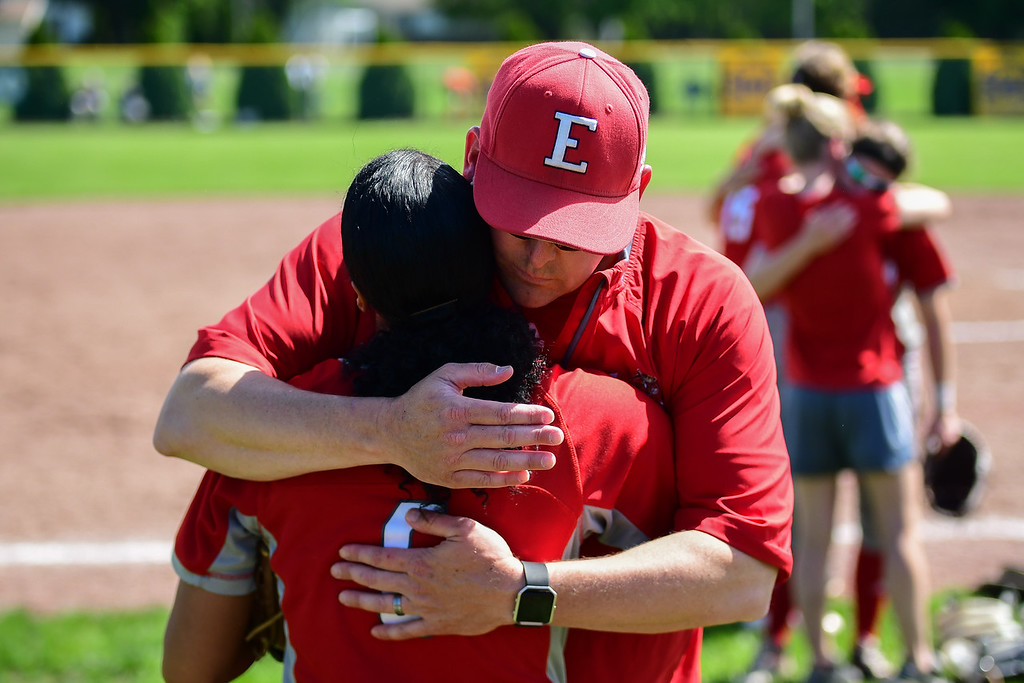 . Eric Bonzar�The Morning Journal<br> Elyria\'s Keearah Williams gets a hug from head coach Ken Fenik after the Pioneer\'s state title defense came to an end, May 23, 2018. The Pioneers fell to the Perrysburg Yellow Jackets, 1-0, in 10 innings.