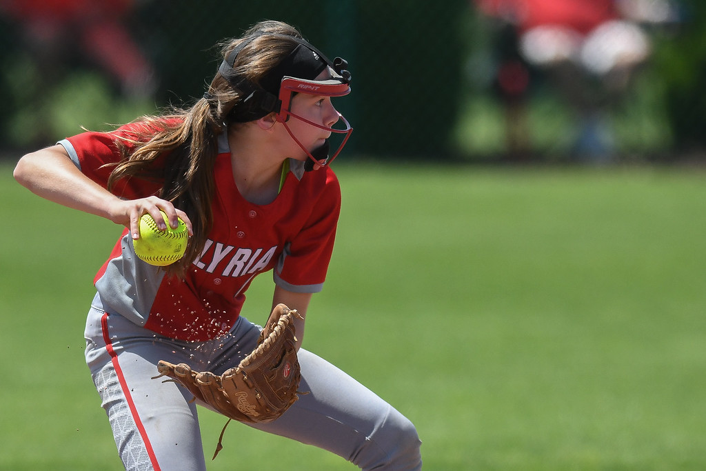 . Eric Bonzar�The Morning Journal<br> Elyria\'s Jessica Chapman throws to first base for an out.