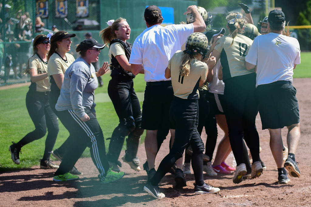 . Eric Bonzar�The Morning Journal<br> The Perrysburg Yellow Jackets celebrate their 1-0 win over the Elyria Pioneers, May 23, 2018.