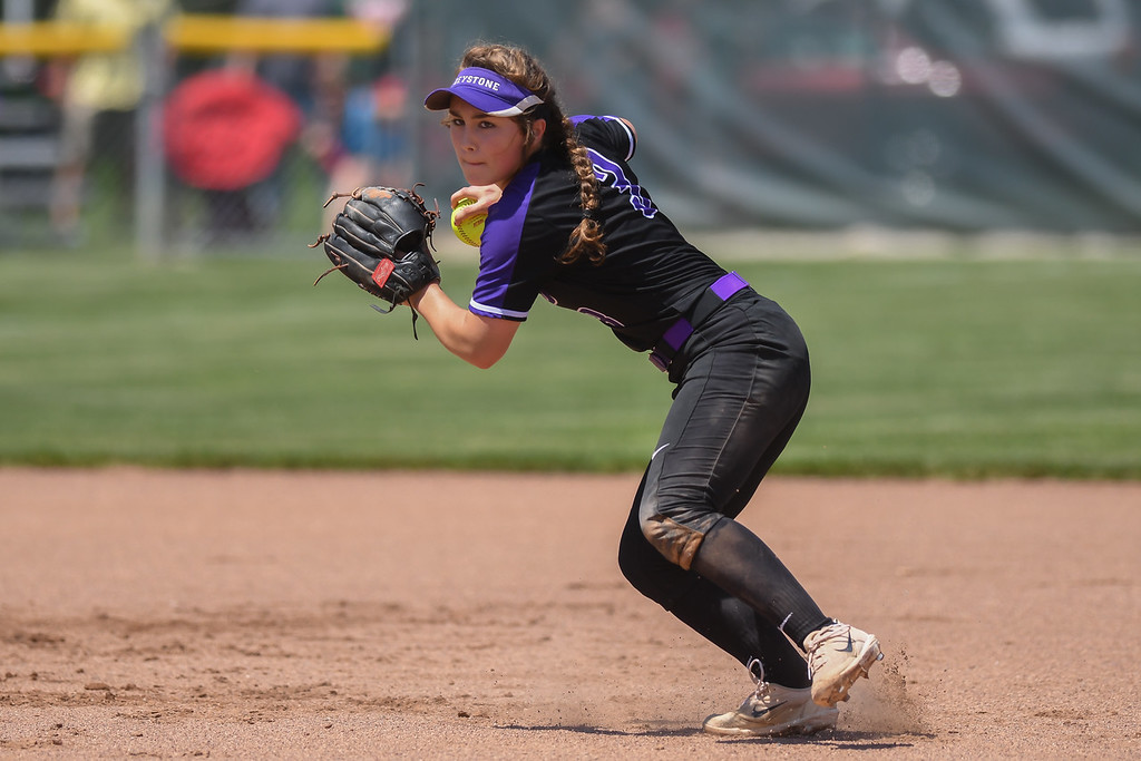 . Eric Bonzar�The Morning Journal<br> Keystone\'s Madi Herrington throws to first for the out.