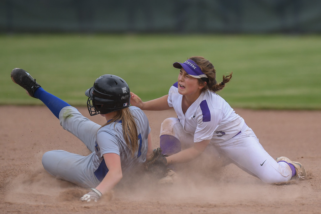 . Eric Bonzar�The Morning Journal<br> Defiance\'s Emalee McKenzie beats the tag from Keystone\'s Madi Herrington at second base.