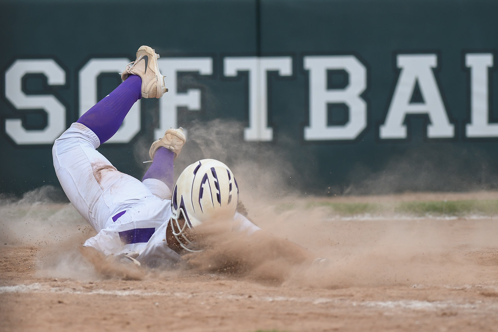 . Eric Bonzar�The Morning Journal<br> Keystone\'s Madi Herrington slides around the tag into home plate.