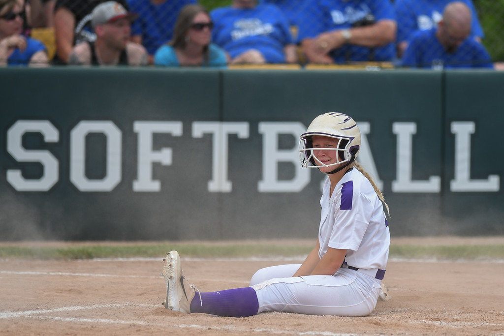 . Eric Bonzar�The Morning Journal<br> Keystone\'s Val Broschk chills out on home plate after scoring a run for the Wildcats.