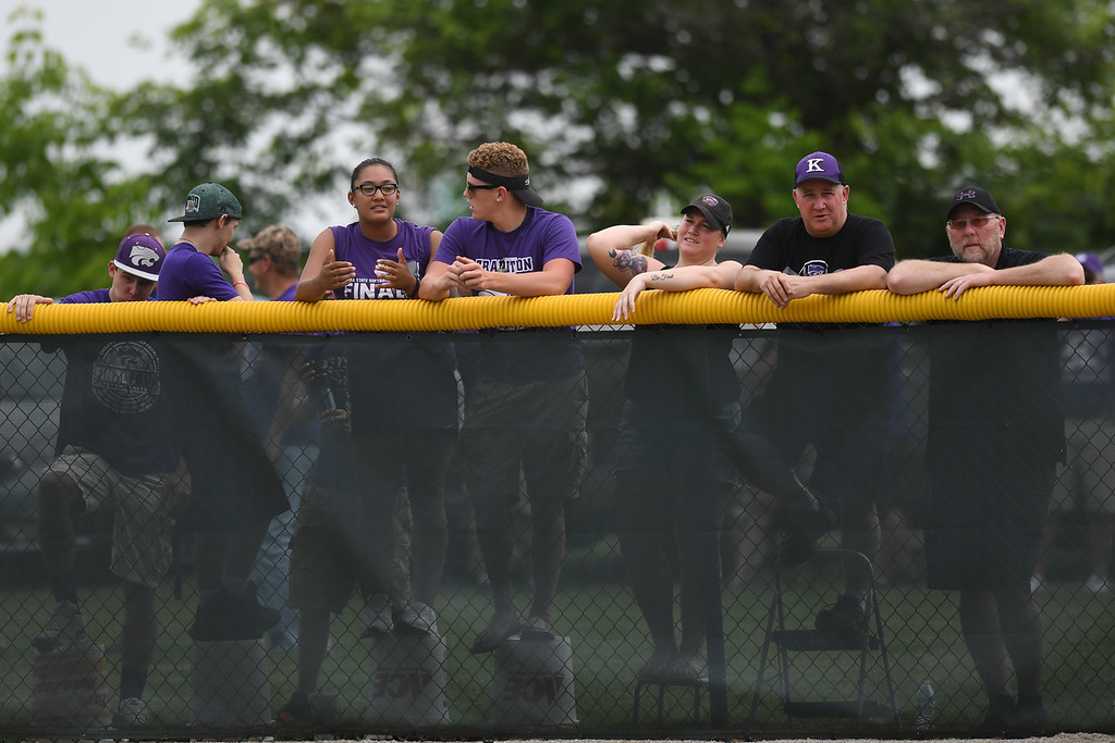 . Eric Bonzar�The Morning Journal<br> Wildcats fans post up on the right field wall to cheer on their team.